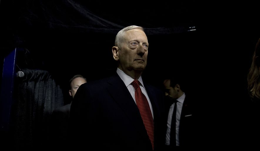 Retired Marine Corps Gen. James Mattis stands backstage as he waits to be announced by President-elect Donald Trump as his Defense Secretary at a rally at the Crown Coliseum in Fayetteville, N.C., Tuesday, Dec. 6, 2016. (AP Photo/Andrew Harnik)