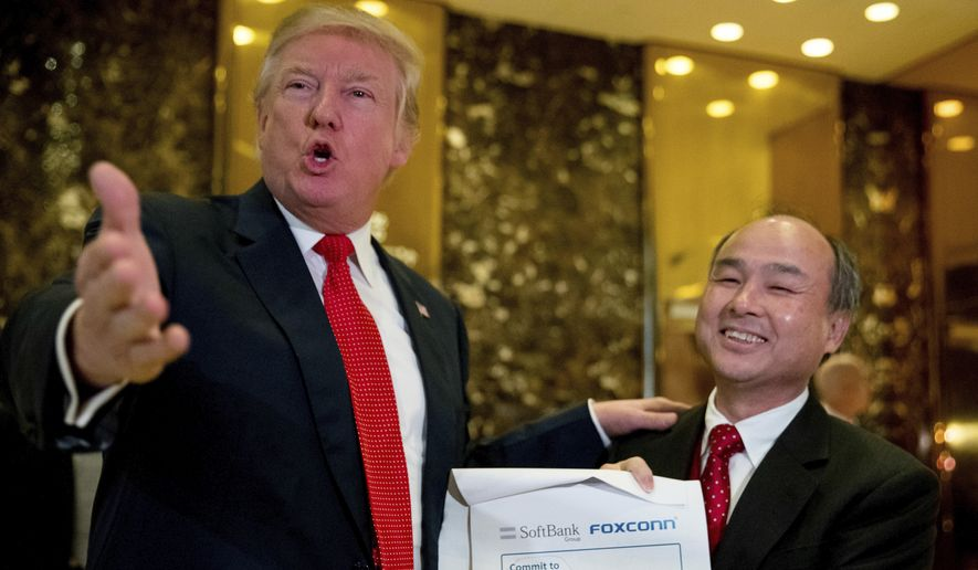 President-elect Donald Trump, accompanied by SoftBank CEO Masayoshi Son, speaks to members of the media at Trump Tower in New York, Tuesday, Dec. 6, 2016. (AP Photo/Andrew Harnik)