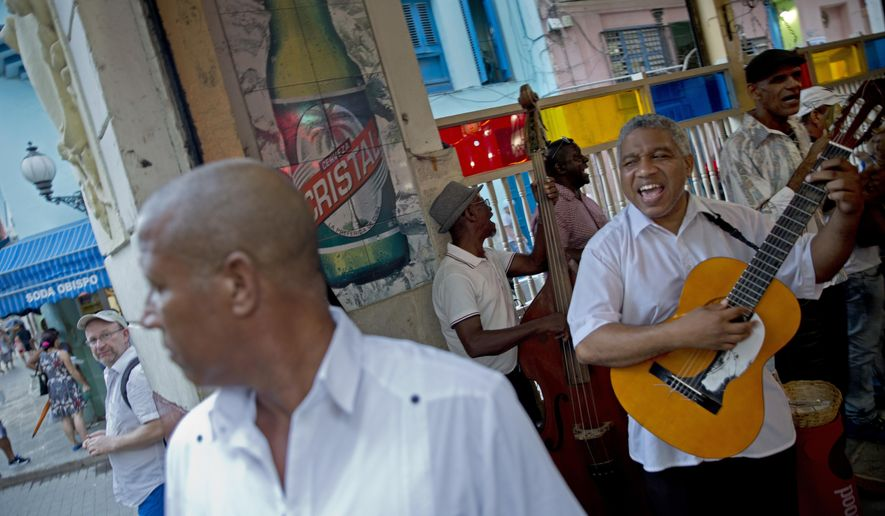 A Cuban band plays at a cafe in Old Havana, Cuba, Monday, Dec. 5, 2016. Nine days of mourning for Fidel Castro end and Cuba begins to resume its life, with music in the streets, alcohol sold again and work returning to a normal pace. (AP Photo/Enric Marti)