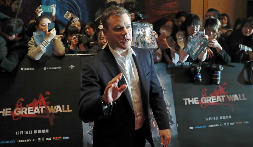 "Actor Matt Damon gestures in front of Chinese fans as he arrives at a red carpet event for the movie ""The Great Wall"" at a hotel in Beijing, Tuesday, Dec. 6, 2016. Damon said Tuesday that his role in the new China-Hollywood production ""The Great Wall"" was always intended to be European, responding to criticism that an Asian actor should have been picked for the part. (AP Photo/Andy Wong)"
