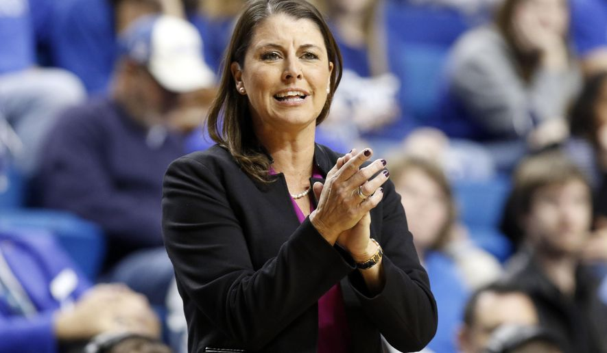 FILE - In this Sunday, Dec. 20, 2015, file photo, Duke head coach Joanne P. McCallie encourages her team during the fourth quarter of an NCAA college basketball game against, Lexington, Ky. McCallie is trying to treat Thursday's game against Elon like any other. It might not be so easy as McCallie's daughter Maddie plays for the Phoenix. (AP Photo/James Crisp, File)