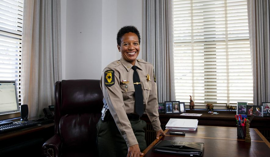In this Nov. 10, 2016 photo, Illinois State Police colonel JoAnne Johnson poses  for a photo in her office at the the state police headquarters in Springfield, Ill. Johnson followed her father, a Chicago police officer, into law enforcement and on Nov. 1, she became the first African American female promoted to the rank of colonel with the Illinois State Police. (Rich Saal/The State Journal-Register via AP)
