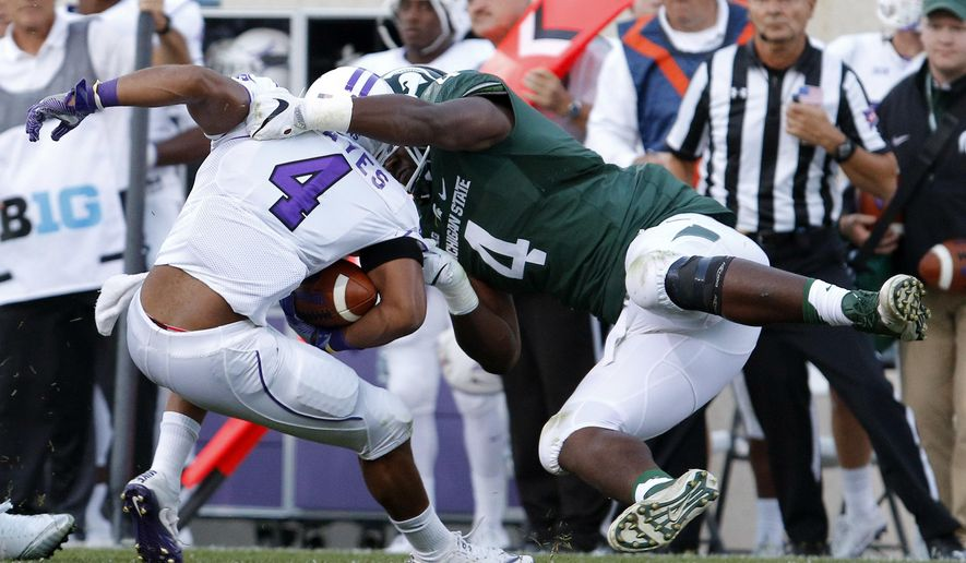 FILE - In this Sept. 2, 2016, file photo, Michigan State's Malik McDowell, right, tackles Furman's Richard Hayes III for a 6-yard loss during the first quarter of an NCAA college football game, in East Lansing, Mich. McDowell is entering the NFL draft, skipping his senior season. The standout defensive lineman made the announcement Tuesday, Dec. 6, 2016. He is projected to be a first-round pick. (AP Photo/Al Goldis, File)
