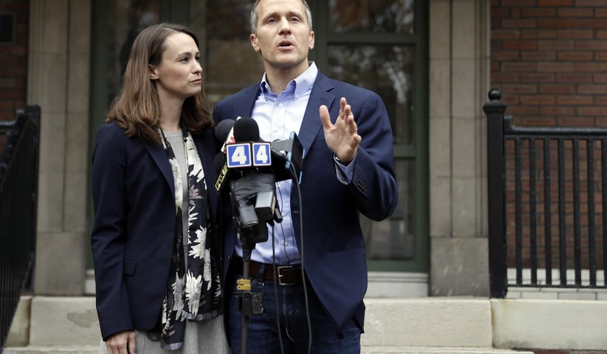 Missouri Gov.-elect Eric Greitens and his wife Sheena speak the the media Tuesday, Dec. 6, 2016, in St. Louis. Sheena Greitens was robbed at gunpoint while sitting in her car on Monday night not far from from the future first family's current St. Louis home. (AP Photo/Jeff Roberson)