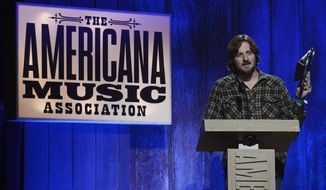 "FILE- In this Sept. 17, 2014, file photo, Sturgill Simpson accepts the Emerging Artist of the Year Award during the Americana Music Honors and Awards show in Nashville, Tenn. Simpson's album, ""A Sailor's Guide to Earth,"" was the surprise underdog nomination for the all-genre album of the year category on Tuesday, Dec. 6, 2016, when Grammy nominations were announced. (AP Photo/Mark Zaleski, File)"