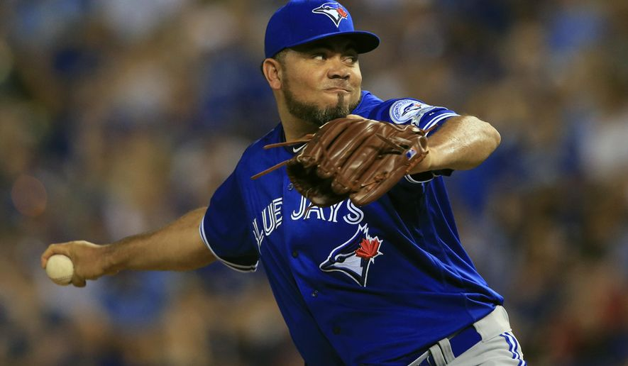 FILE - In this Aug. 5, 2016, file photo, Toronto Blue Jays relief pitcher Joaquin Benoit throws during a baseball game against the Kansas City Royals at Kauffman Stadium in Kansas City, Mo. A person familiar with the negotiations says reliever Joaquin Benoit and the Philadelphia Phillies have agreed to a $7.5 million, one-year contract. The person spoke on condition of anonymity to The Associated Press on Monday, Dec. 5, 2016, because the agreement had not yet been announced. (AP Photo/Orlin Wagner, File)