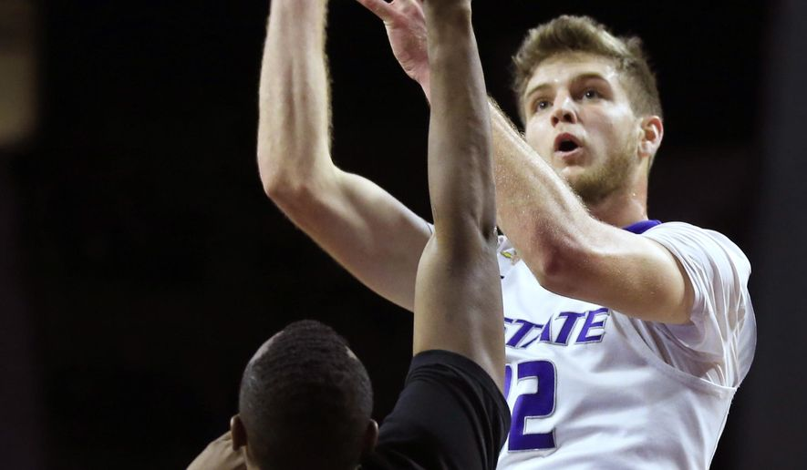 Kansas State forward Dean Wade (32) shoots over Prairie View A&M forward Nolan Wilson (15) during the second half of an NCAA college basketball game in Manhattan, Kan., Tuesday, Dec. 6, 2016. (AP Photo/Orlin Wagner)