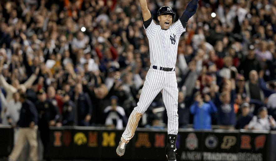 FILE - In this Sept. 25, 2014, file photo, New York Yankee Derek Jeter jumps after hitting the game-winning single against the Baltimore Orioles in the ninth inning of a baseball game, in New York. It was Jeter's last home game of his career at Yankee Stadium. Jeter's No. 2 is being retired, the last of the New York Yankees' single digits. The Yankees said Tuesday, Dec. 6, 2016, the number will be retired on May 14 before a Mother's Day game against Houston, and a plaque in his honor will be unveiled in Monument Park during the ceremony. (AP Photo/Julie Jacobson, File)