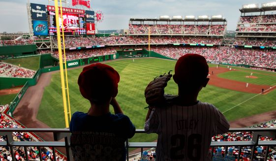 Southwest waterfront residents fear their neighborhood could see their community become polluted after the D.C. Council on Tuesday passed a measure that allows massive LED billboards to be installed on Nationals Park's exterior walls. (Associated Press)