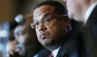 In a Dec. 2, 2016, file photo, U.S. Rep. Keith Ellison, D-Minn., listens with Jamie Harrison, back, chair of the South Carolina Democratic Party, as Ray Buckley, chair of the party in New Hampshire, speaks during a forum on the future of the Democratic Party, in Denver. Ellison said Wednesday, Dec. 7, 2016,  that he'll resign his seat in Congress if he's picked as chairman by DNC members at the late February elections. (AP Photo/David Zalubowski, File)