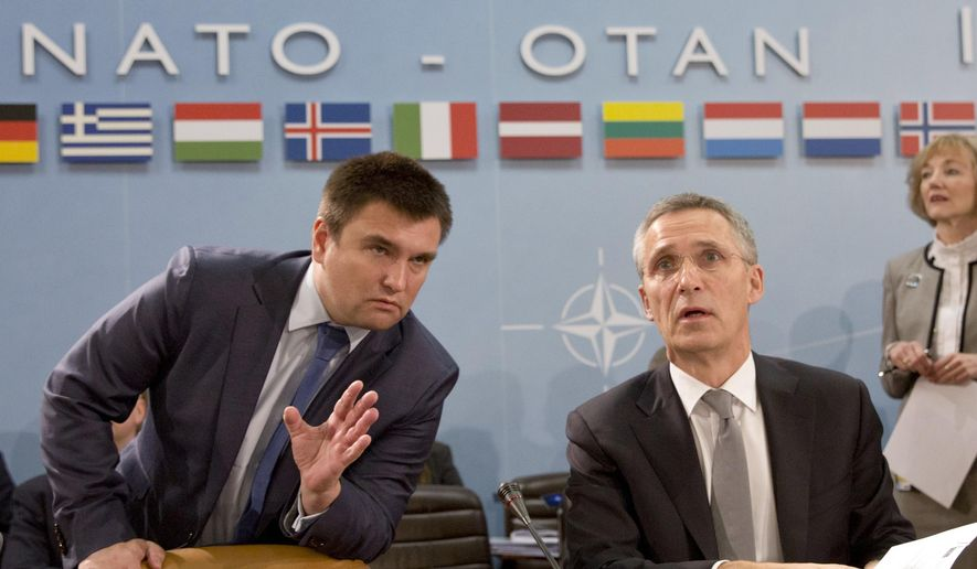 Ukrainian Foreign Minister Pavlo Klimkin, left, speaks with NATO Secretary General Jens Stoltenberg during a round table meeting of the NATO-Ukraine Commission at foreign ministers level at NATO headquarters in Brussels on Wednesday, Dec. 7, 2016. (AP Photo/Virginia Mayo)