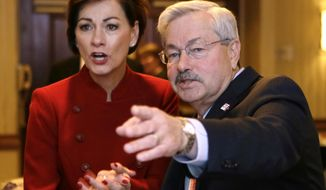 FILE - In this Nov. 4, 2014, file photo, Iowa Gov. Terry Branstad and Lt. Gov. Kim Reynolds, left, watch early election returns in West Des Moines, Iowa. An aide to President-elect Donald Trump confirmed Wednesday, Dec. 7, 2016, that Trump has offered to nominate Branstad as U.S. ambassador to China. The likely departure of the nation's longest-serving governor to accept the appointment means Iowa could be led by its first female governor. (AP Photo/Charlie Neibergall, File)