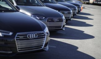 "A line of Audi A4 cars are parked before a demonstration of Audi's vehicle-to-infrastructure technology Tuesday, Dec. 6, 2016, in Las Vegas. The technology allows vehicles to ""read"" red lights ahead and tell the driver how long it'll be before the signal turns green. For the driver, the system puts a traffic signal icon on the dashboard telling how many seconds the light will remain red. (AP Photo/John Locher)"