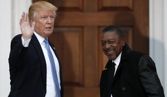 In this Nov. 20, 2016, photo, President-elect Donald Trump stands with BET founder Robert Johnson at the Trump National Golf Club Bedminster clubhouse in Bedminster, N.J. (AP Photo/Carolyn Kaster) **FILE**