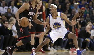 "In this photo taken on Thursday, Dec. 1, 2016, Golden State Warriors' Patrick McCaw, right, guards Houston Rockets' Eric Gordon (10) during the second half of an NBA basketball game in Oakland, Calif. The kid they call ""P Nice"" because his game is so good, so young, is getting comfortable in his first NBA season, and it certainly helps playing alongside a star-studded cast of KD, Stephen Curry, Klay Thompson and Draymond Green every day. (AP Photo/Ben Margot)"
