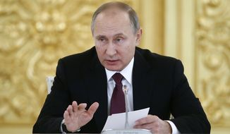 Russia's President Vladimir Putin delivers a speech during a session of the Council for Civil Society and Human Rights at the Kremlin in Moscow, Russia, Thursday Dec. 8, 2016. (Sergei Karpukhin/Pool photo via AP)