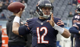 FILE - In this Sunday, Nov. 27, 2016 file photo, Chicago Bears quarterback Matt Barkley (12) warms up before an NFL football game against the Tennessee Titans in Chicago. Chicago Bears quarterback Matt Barkley likened his return to playing football regularly with riding a bicycle. The terrain beneath Barkley's tires becomes much rougher, so to speak,  when he makes his first NFL road start Sunday, Dec. 11, 2016 at Detroit against the first-place Lions (8-4). (AP Photo/Nam Y. Huh, File)