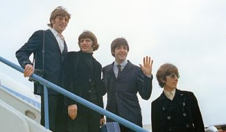 This 1966 file photo shows The Beatles, from left, John Lennon, Ringo Starr, Paul McCartney and George Harrison as they leave London Airport on their trip to the U.S. and Canada. (AP Photo/File)