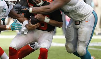 FILE - In this Sept. 25, 2016, file photo, Cleveland Browns quarterback Cody Kessler (6) is sacked by Miami Dolphins defensive tackle Ndamukong Suh (93) during overtime at an NFL football game,in Miami Gardens, Fla. The Arizona Cardinals take on the Miami Dolphins on Sunday in Miami Gardens, Fla.  (AP Photo/Wilfredo Lee, File)