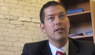 In this June 30, 2010, file photo, Sean Duffy, then a congressional candidate, speaks during an interview in Madison, Wis. (AP Photo/Ryan Foley, File)