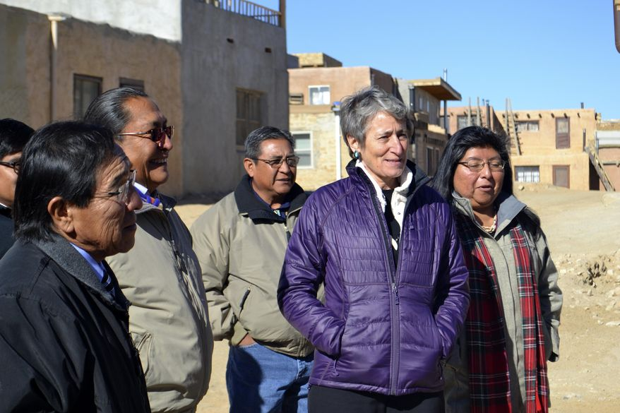 U.S. Interior Secretary Sally Jewell, second from right, tours Acoma Pueblo, a nearly thousand-year-old village that's situated atop a New Mexico mesa, with tribal leaders on Thursday, Dec. 8, 2016. Jewell says the visit to Acoma Pueblo is expected to be her last to a reservation as secretary of the Interior, which oversees the Bureau of Indian Affairs. (AP Photo/Mary Hudetz)