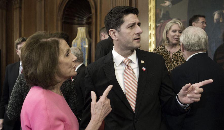 House Speaker Paul Ryan of Wis. talks with House Minority Leader Nancy Pelosi of Calif. on Capitol Hill in Washington, Thursday, Dec. 8, 2016. (AP Photo/Cliff Owen) ** FILE **