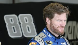 FILE - In this July 1, 2016, file photo, Dale Earnhardt Jr. prepares before the start of practice at Daytona International Speedway, in Daytona Beach, Fla. Earnhardt, who missed the final 18 races of last season because of a concussion, has been medically cleared to return next year. Hendrick Motorsports announced Thursday, Dec. 8, 2016, that Earnhardt will take part in the season-opening Daytona 500. (AP Photo/Wilfredo Lee, File)