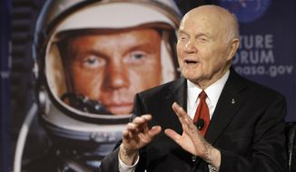 "FILE - In this Feb. 20, 2012, file photo, U.S. Sen. John Glenn talks with astronauts on the International Space Station via satellite before a discussion titled ""Learning from the Past to Innovate for the Future"" in Columbus, Ohio. Glenn, who was the first U.S. astronaut to orbit Earth and later spent 24 years representing Ohio in the Senate, has died at 95. (AP Photo/Jay LaPrete, File)"