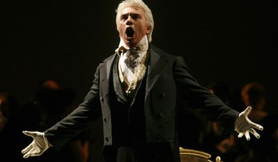 """FILE - In this Feb. 6, 2007 file photo, Dmitri Hvorostovsky performs during the final dress rehearsal for the opera """"Eugene Onegin"""" in New York.  Hvorostovsky has withdrawn from staged opera performance because of treatment for a brain tumor.   Hvorostovsky says in a statement Thursday, Dec. 8, 2016,  that """"I have been experiencing balance issues associated with my illness, making it extremely difficult for me to perform in staged productions.""""  (AP Photo/Shiho Fukada)"""