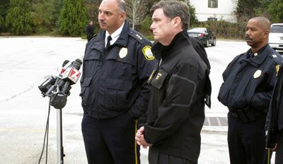 Columbia Police Chief Skip Holbrook, left, and South Carolina Corrections Department Director Bryan Stirling, center, discuss the recapture of escaped state prison inmate Michael Williamson on Thursday, Dec. 8, 2016, in Columbia, S.C.  (AP Photo/Jeffrey Collins)