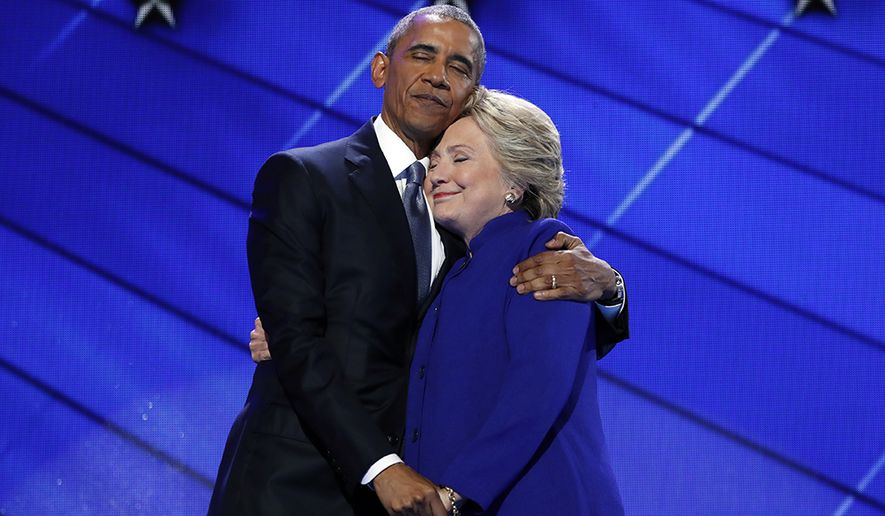 President Barack Obama hugs Democratic Presidential candidate Hillary Clinton after addressing the delegates during the third day session of the Democratic National Convention in Philadelphia, on July 27, 2016. (AP Photo/Carolyn Kaster, File) ** FILE **