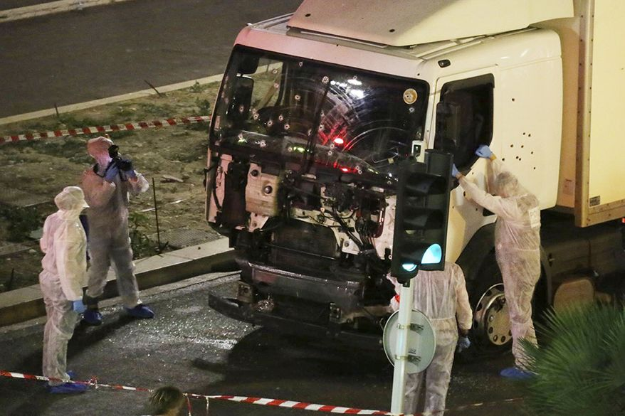Authorities investigate a truck after it plowed through Bastille Day revelers in the French resort city of Nice, France, on July 14, 2016. France was ravaged by its third attack in two years when a large white truck mowed through revelers gathered for Bastille Day fireworks in Nice, killing dozens of people as it bore down on the crowd for more than a mile along the Riviera city's famed seaside promenade. (Sasha Goldsmith via AP, File)