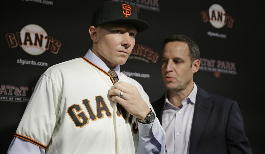 San Francisco Giants pitcher Mark Melancon, left, with his agent, Mark Pieper, right, after he was introduced at AT&T Park Friday, Dec. 9, 2016, in San Francisco. (AP Photo/Eric Risberg)