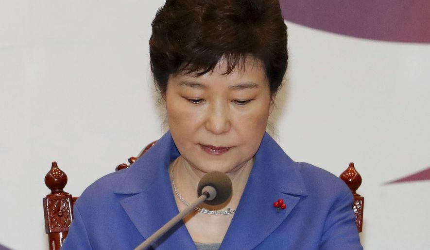 South Korean President Park Geun-hye attends an emergency Cabinet meeting at the presidential office in Seoul, South Korea, Friday, Dec. 9, 2016. South Korean lawmakers earlier on Friday impeached Park, a stunning and swift fall for the country's first female leader amid protests that drew millions into the streets in united fury. (Baek Sung-ryul/Yonhap via AP)