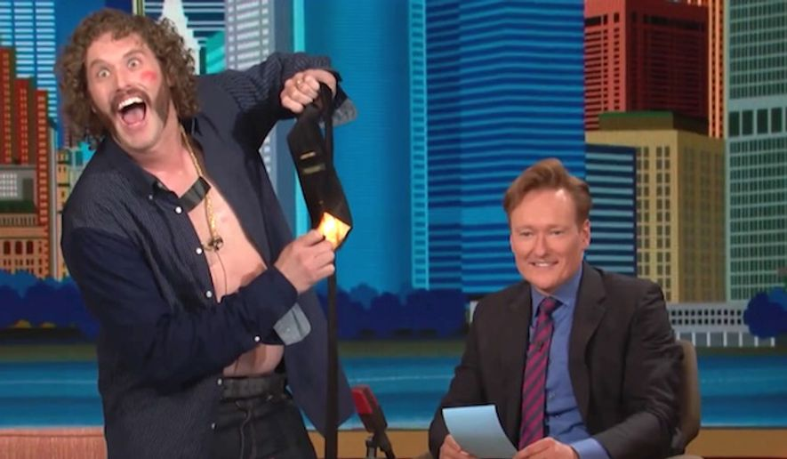 "Comedian T.J. Miller burns a Trump tie on ""The Conan Show"" in November 2016. (YouTube, Team Coco)"