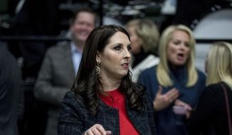 Michigan Republican Party Chairman Ronna Romney McDaniel arrives before President-elect Donald Trump takes the stage at a rally at DeltaPlex Arena, Friday, Dec. 9, 2016, in Grand Rapids, Mich. (AP Photo/Andrew Harnik) ** FILE **