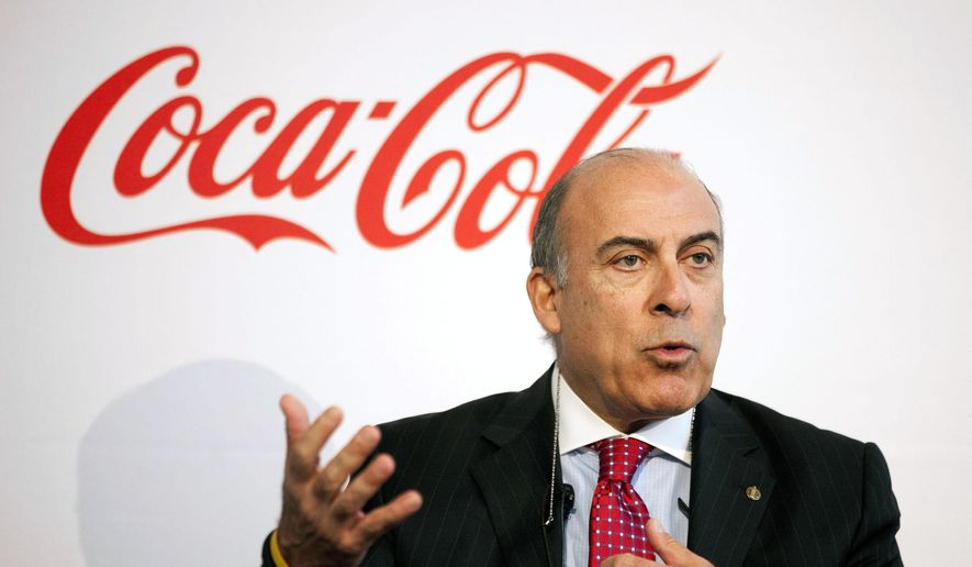 In this May 8, 2013, file photo, Coca-Cola CEO Muhtar Kent speaks during a news conference in Atlanta.  Coca-Cola said Friday, Dec. 9, 2016, that Kent will step down as CEO next year and be replaced by Chief Operating Officer James Quincey. (AP Photo/David Goldman, File)