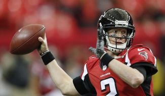 FILE - In this Sunday, Nov. 27, 2016 file photo, Atlanta Falcons quarterback Matt Ryan (2) warms up before the first of an NFL football game between the Atlanta Falcons and the Arizona Cardinals in Atlanta. When Jared Goff was preparing to become the No. 1 pick in the NFL draft earlier this year, many scouts and observers compared him to Matt Ryan, the veteran quarterback of the Atlanta Falcons. (AP Photo/John Bazemore, File)