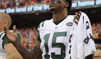 """FILE - In this Sept. 25, 2016, file photo, New York Jets wide receiver Brandon Marshall (15) gestures during the playing of the national anthem before an NFL football game against the Kansas City Chiefs, in Kansas City, Mo. The Jets (3-9) take their four-game losing streak to the Bay Area on Sunday when they will face the San Francisco 49ers (1-11).  """"One of the things we always talk about with sports is it teaches us certain life lessons and it brings out the best in us or exposes the worst in us,"""" Jets receiver Brandon Marshall said. """"This is a great season for both teams to really mature and grow not only as a team and organization but also as men.""""  (AP Photo/Charlie Riedel, File)"""