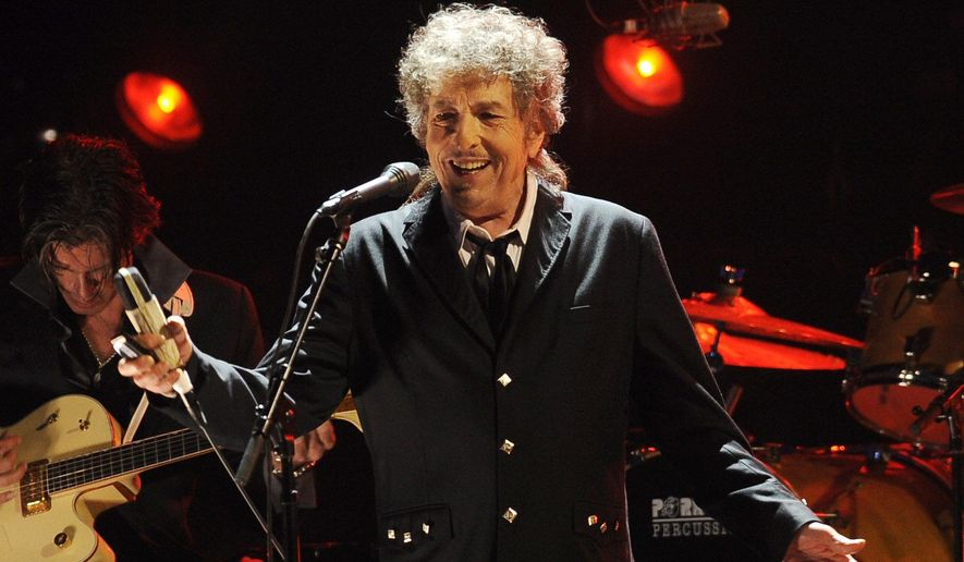 In this Jan. 12, 2012, photo, Bob Dylan performs in Los Angeles. (AP Photo/Chris Pizzello) **FILE**
