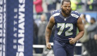 FILE - In this Oct. 16, 2016, file photo, Seattle Seahawks defensive end Michael Bennett (72) runs on the field before an NFL football game against the Atlanta Falcons, in Seattle. The Green Bay Packers need to beat the Seahawks Sunday to keep pace with first-place Detroit in the NFC North.EAP Photo/Elaine Thompson, File)
