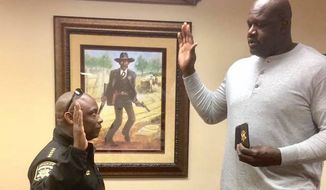 Clayton County Sheriff Victor Hill posted several photos on Facebook of Shaq being sworn in Saturday. (Facebook/@Sheriff Victor Hill)