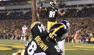 FILE - In this Dec. 4, 2016, file photo, Pittsburgh Steelers wide receiver Antonio Brown (84) celebrates after catching a touchdown pass during the first half of an NFL football game against the New York Giants, in Pittsburgh. Following a four-game swoon, the Steelers (7-5) are on a roll in having won three straight to move into a tie with Baltimore atop the AFC North in preparing to travel to play the Buffalo Bills (6-6) on Sunday. (AP Photo/Don Wright, File)