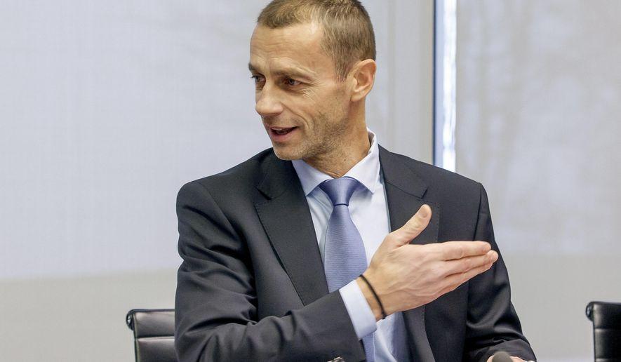 UEFA president Aleksander Ceferin gestures prior to the UEFA Executive Committee at the UEFA Headquarters, in Nyon, Switzerland, Friday, Dec. 9, 2016. (Salvatore Di Nolfi/Keystone via AP)