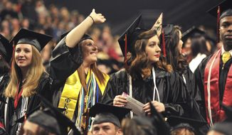 A record 1,405-member fall graduating class attend the Arkansas State University Commencement Ceremony on Saturday, Dec. 10, 2016, in Jonesboro, Ark. (Staci Vandagriff /The Jonesboro Sun via AP)