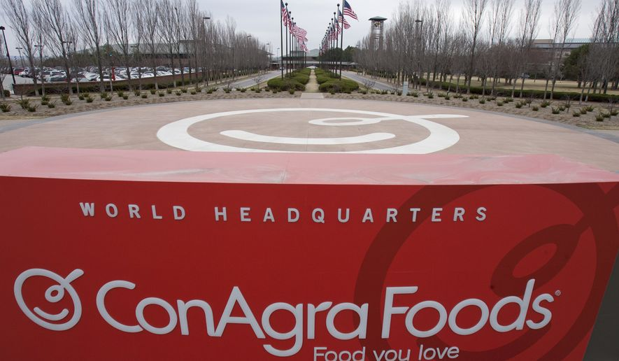 This March 21, 2011, file photo shows a sign for ConAgra Foods' world headquarters in Omaha, Neb. ConAgra is heading to court to finalize an $11.2 million plea deal in a federal criminal case stemming from a salmonella outbreak that sickened hundreds who ate tainted Peter Pan peanut butter.  A federal judge in Albany, Georgia, is scheduled to decide Thursday, Dec. 15, 2016, whether to approve the settlement reached with Justice Department prosecutors in May 2015. (AP Photo/Nati Harnik, File)