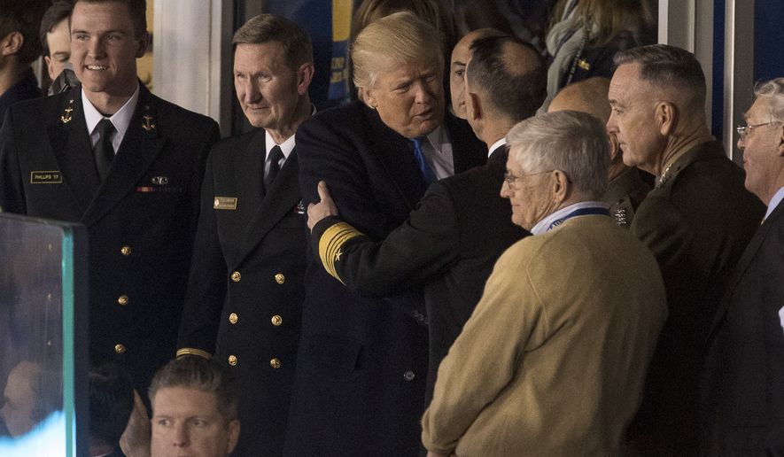 President-elect Donald Trump speaks with members of the military, including Joint Chiefs Chairman Gen. Joseph Dunford, second from right, during an Army-Navy NCAA college football game Saturday, Dec. 10, 2016, in Baltimore. (AP Photo/Andrew Harnik)