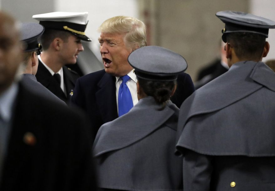 President-elect Donald Trump greets Army Cadets and Navy Midshipmen before the Army-Navy NCAA college football game in Baltimore, Saturday, Dec. 10, 2016. (AP Photo/Patrick Semansky)