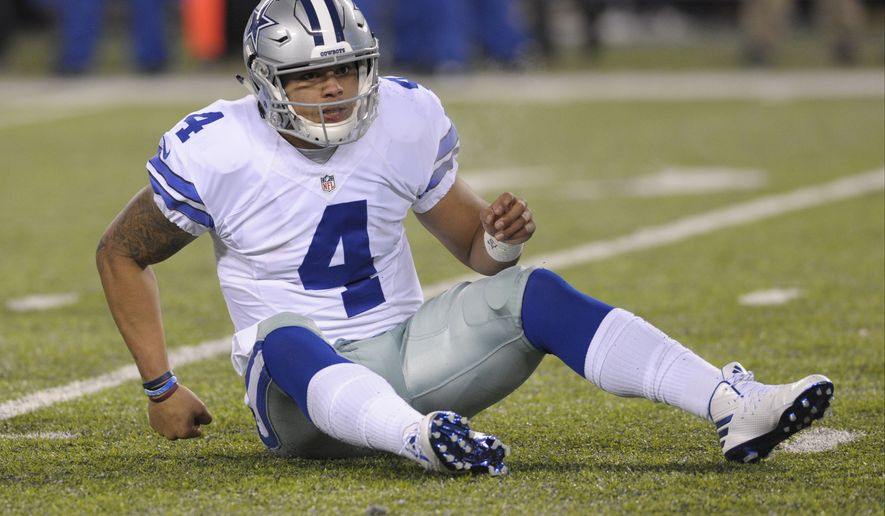 Dallas Cowboys quarterback Dak Prescott (4) reacts after being knocked down during the second half of an NFL football game against the New York Giants Sunday, Dec. 11, 2016, in East Rutherford, N.J. (AP Photo/Bill Kostroun)