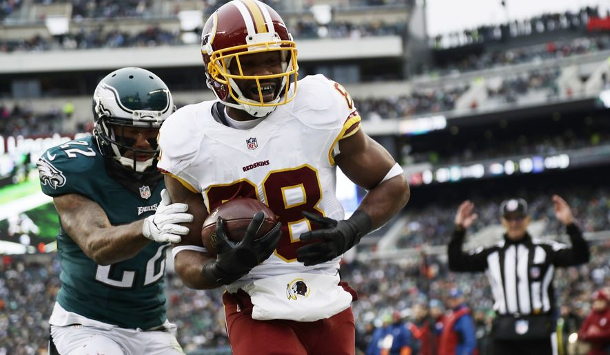 Washington Redskins' Pierre Garcon, right, scores a touchdown past Philadelphia Eagles' Nolan Carroll during the second half of an NFL football game, Sunday, Dec. 11, 2016, in Philadelphia. (AP Photo/Michael Perez)